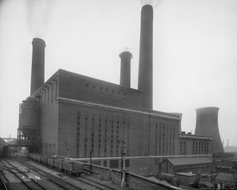 "Ex-Scotland.  Power Station Buildings.  Stuart Street Power Station, Bradford, Manchester, England. General view of boiler and turbine houses. Insc verso: 'Boiler house Portals span 120'   113'6"" high at centre 112' 0"" high at eaves WT[weight] 95 Tons each' Dated: '4.10.49' Stamped verso: 'Stewart Bale Ltd, Commercial Photographers, 13 Union Court, Liverpool', '[Negative] reference number 49869-2', 'Stuart Street Power Station Bradford, Manchester, 11'."