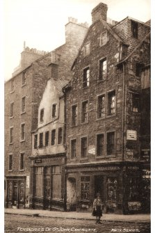 Postcard view of St John's Street, 184-186 Canongate, St John's Close and 190 Canongate.