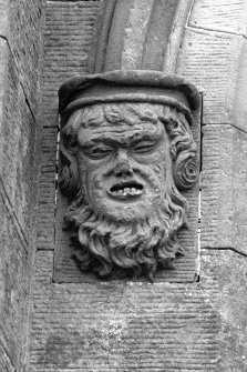 Castle Toward, South Lodge. Detail of grotesque mask stop at entrance archway of South Lodge.