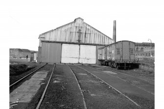 Dalmellington, Waterside Ironworks, Locomotive Repairs Workshops View from ESE showing ESE front of W locomotive shed with NCB vans in foreground