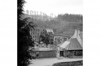 New Lanark, 5 and 7 Rosedale Street, David Dale's House View from NE showing part of mill number 1 and mill number 2 with part of David Dale's House in foreground