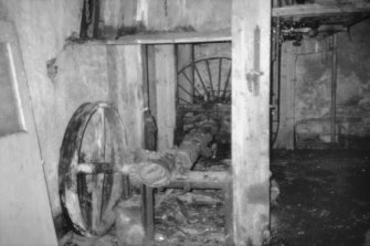 Castletown, Castlehill Mill View from E at ground floor level, N range showing mill-stone drive shaft and gear remains