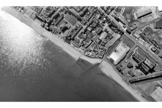 Scanned image of vertical aerial photograph BKS 2275: 184 Showing Portobello, including Portobello Power Station and Portobello Open Air Swimming Pool. Date: 1973