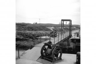St Andrews Harbour, Rolling Suspension Footbridge General view from WNW showing bridge and winches