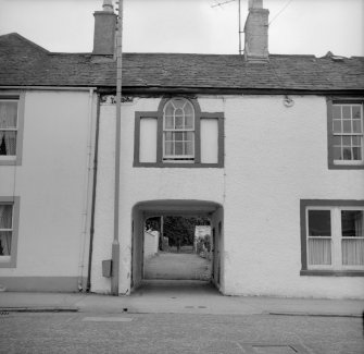 Gatehouse of Fleet, 38 High Street, Terraced House and Pend View from NW showing pend under part of number 38