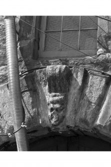 Edinburgh, Quayside Street, Quayside Mills, St. Ninian's Church and Manse. View of carved keystone over rusticated archway of entrance pend. Grotesque mask, much weathered.