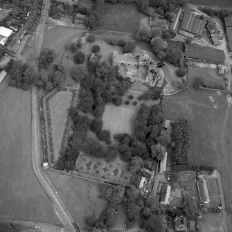 Dirleton Castle, oblique aerial view, taken from the WSW. The cropmark of a possible building is visible on Dirleton Village Green in the centre left of the photograph.