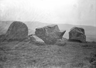 View of recumbent stone and flankers. Original negative captioned: 'Ardlair Stone Circle, Kennethmont, Recumbent Stone from inside of circle August 1905'.