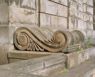 Detail of decorative console at base of pilaster on south pavillion