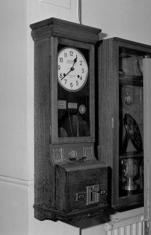 Station headquarters, hall, detail of clocking-in machine