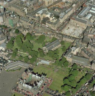 Scanned image of oblique aerial view, taken from the SSW, centred on Candlemaker Row, Greyfriars Church and burial-ground.