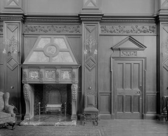 Interior-detail of fireplace and doorway in Great Hall of Craig House