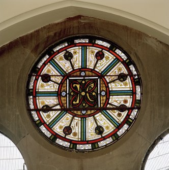 Interior. Detail of remaining stained glass in hall.