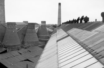 View from 2nd floor of making shop, looking SW at flint calcining kilns. Digital image of B 9413