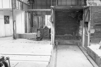 Interior View of 'intake' end of north side tunnel kiln with pusher on left side of door Digital image of B 9427