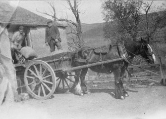 Photographic copy of photo taken before 1940, showing Mr McIntosh (miller) with sack barrow, and his father-in-law, Mr George Milne on cart.