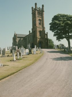 View from WNW showing WSW and NNW fronts of church with churchyard in foreground