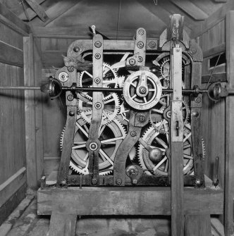 Tower. Second level.  Detail of clock mechanism.