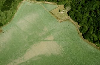 Digital image of Cambusmichael, oblique aerial view, taken from the SSW, centred on the cropmarks of the Grange. Cambusmichael Church is visible in the top half of the photograph.