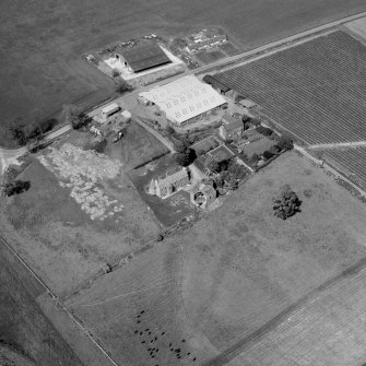 Oblique aerial view centred on Powrie Castle.