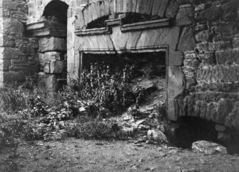 View of fireplace in hall, Powrie Castle.