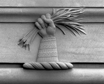 Detail of William Broom's crest a hand clasping some broom