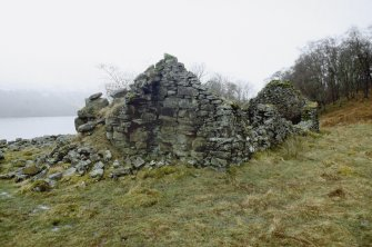 Ruined byre dwelling (BL00 738), showing fragment of possible laird's house incorporated into the NE gable. View from NNE.