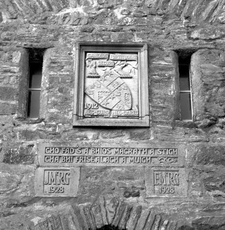 Scanned image of Eilean Donan Castle. Detail of MacRae Gilstrap Arms above portcullis.