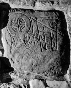Digital copy of view of symbol stone built into wall, Arndilly
