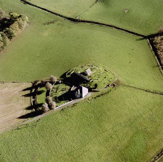 Oblique aerial view of Kildrummy, St Bride's Chapel and Well centred on the church with a possible motte and churchyard adjacent, taken from the NW.
