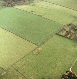 Oblique aerial view centred on the remains of the recumbent stone circle with stone circle and cairn adjacent, taken from the NW.