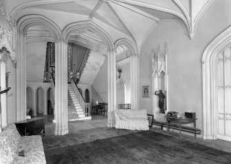 Skye, Armadale Castle, interior. Interior view of hall and staircase.