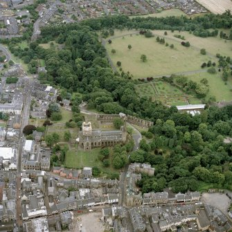 Oblique aerial view centred on the abbey, with the town hall, library and Abbots House adjacent, taken from the N.
