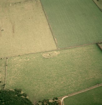 Oblique aerial view centred on the remains of the recumbent stone circle, taken from the WNW.