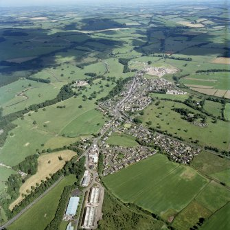 Oblique aerial view centred on the town with the castle adjacent, taken from the NW.