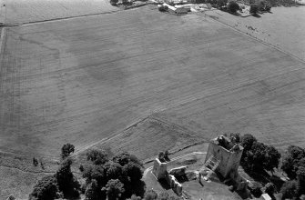 Oblique aerial view centred on the remains of Spynie Palace, looking to the SSW.