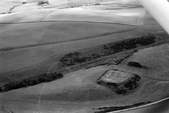 Oblique aerial view centred on the remains of the motte and bailey at Peel of Fichlie, looking to the S.