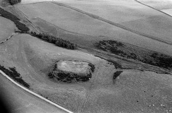Oblique aerial view centred on the remains of the motte and bailey at Peel of Fichlie, looking to the SE.