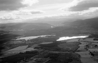 General oblique aerial view of Loch Kinord and Loch Davan beyond, looking to the SW.