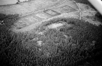 Oblique aerial view centred on the remains of the vitrified fort at Craig Phadrig, looking to the NW.