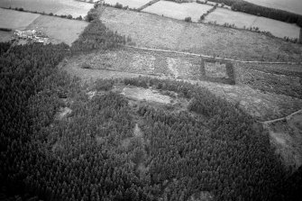 Oblique aerial view centred on the remains of the vitrified fort at Craig Phadrig, looking to the WNW.