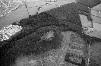 Oblique aerial view centred on the remains of the vitrified fort at Craig Phadrig, looking to the S.