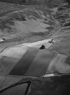 Oblique aerial view centred on Corgarff Castle, looking to the S.