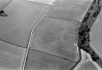 Oblique aerial view centred on the cropmarks of the enclosures, ring ditches and pits at Kirkton and Balmullie Mill, looking to the WSW.