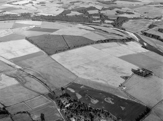Oblique aerial view centred on the cropmarks of the Roman Temporary Camp at Normandykes, looking to the SE.