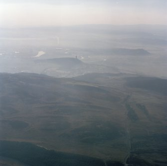 Oblique aerial view from NE.