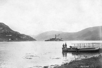 Eilean Donan Castle. Distant view from North-West, during reconstruction  . Insc: '3417/28'.
