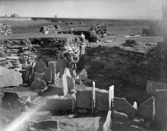 Image showing excavations by Sir Francis Tress Barry.  Interior, standing slabs. Barry is standing in centre.