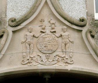 Leith Hall, exterior.  West range entrance pend: detail of pediment with Leith-Hay armorial