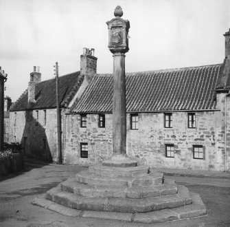 Digital copy of view of Mercat Cross with MacLean's Buildings behind from SW.